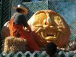 Farmer Mike carving a giant pumpkin